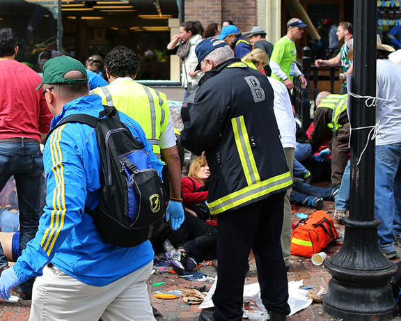 BOSTON - APRIL 15: Emergency personnel respond to the scene of the first explosion on Boylston Street near the finish line of the 117th Boston Marathon, April 15, 2013. (Photo by John Tlumacki/The Boston Globe via Getty Images)
